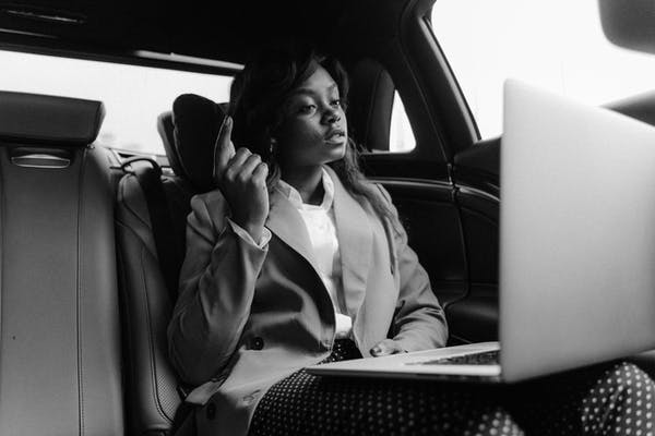 grayscale-photo-of-woman-sitting-inside-a-car-p5717570
